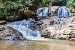 Scenic waterfall flowing on stone, North Thailand. Scenic waterfall flowing on stone at Mae Sa waterfall Doi Suthep-Pui national park, North Thailand Stock Image