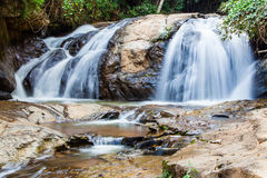 Scenic waterfall flowing on stone, North Thailand Stock Photography