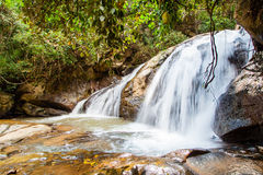 Scenic waterfall flowing on stone, North Thailand Stock Photos