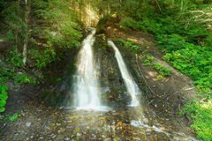 Scenic waterfall in forest. Stock Images