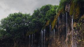 Scenic waterfall in the forest flowing down from the rock stock footage