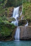 Scenic waterfalls and lush vegetation in Jamaica Stock Photography