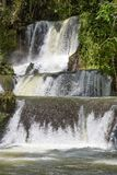 Scenic waterfalls and lush vegetation in Jamaica stock images