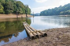 Scenic waterscape with bamboo raft in Periyar National Park, India. This amazing wildlife park is located in Kerala southern state of India. Sprawled over an royalty free stock photos