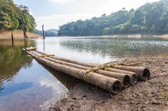 Scenic waterscape with bamboo raft in Periyar National Park, India. This amazing wildlife park is located in Kerala southern state of India. Sprawled over an stock photography