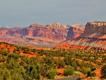 Scenic Way a Park Road in Capitol Reef National Park, Utah, USA. Grand view of Orange cliffs, geographic formations and vegetation Stock Photo
