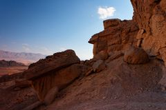 Scenic weathered orange rock in stone desert on su Royalty Free Stock Image