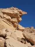 Scenic weathered yellow rock in stone desert Stock Photos