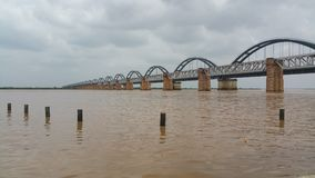 Scenic wide view of arch railway bridge on a river. royalty free stock images