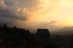 Scenic wiew on the Meteora, Greece. People looking on sunrice about valley Meteora royalty free stock images