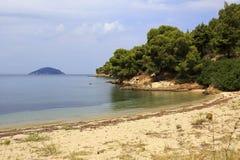 Scenic wild beach and Kelyfos Island. Royalty Free Stock Photo