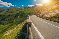 Scenic Winding Alpine Road. Great St Bernard Pass Road Connecting Switzerland and Aosta Valley in the Italy Royalty Free Stock Images