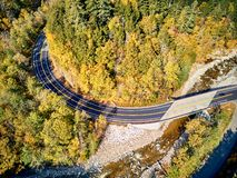 Scenic winding highway in autumn. Scenic Mohawk Trail winding highway at autumn, Massachusetts, USA. Fall in New England. Aerial drone shot royalty free stock photography