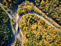 Scenic winding highway in autumn. Scenic Mohawk Trail winding highway at autumn, Massachusetts, USA. Fall in New England. Aerial drone shot royalty free stock image
