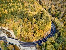 Scenic winding highway in autumn. Scenic Mohawk Trail winding highway at autumn, Massachusetts, USA. Fall in New England. Aerial drone shot royalty free stock photos