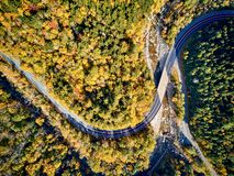 Scenic winding highway in autumn. Scenic Mohawk Trail winding highway at autumn, Massachusetts, USA. Fall in New England. Aerial drone shot stock photo