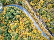 Scenic winding highway in autumn. Scenic Mohawk Trail winding highway at autumn, Massachusetts, USA. Fall in New England. Aerial drone shot stock image