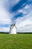 Scenic windmill on meadow, rural landscape Stock Images