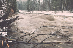 Scenic winter colored river in country - vintage retro Royalty Free Stock Images