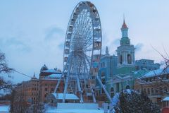 Scenic winter landscape of city Kyiv. View of the Ferris wheel on Kontraktova Square Square of Contracts. Podil is one of the oldest districts of Kyiv. Ukraine royalty free stock images