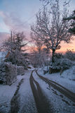 Scenic winter with road at sunset Royalty Free Stock Photos