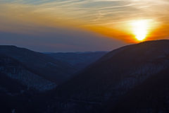 A scenic winter sunset over black hills in Appalachian Mountains in West Virginia, USA. Stock Photos