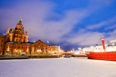 Scenic winter view the frozen Old Port in Katajanokka district with Uspenski Orthodox Cathedral in Helsinki Finland royalty free stock photos