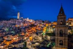 Sceniczny widok w ` Sassi ` okręgu Matera przy zmierzchem, Basilicata, południowy Włochy obraz royalty free