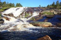 Scenisk vattenfall i Norge Arkivbilder