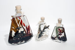 Scent. Three decorative bottles of aromatic oil (liquid wax Royalty Free Stock Photography