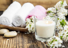 Scent Candle with White Flowers and Towels for Spa Stock Image