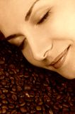 Scent of a coffee. Picture of a beautiful woman scenting coffee beans Stock Photo