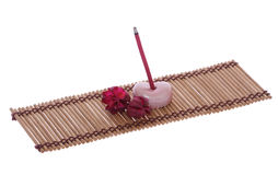 Scent joss stick, pebble and flower on mat for mental relaxation Stock Photos