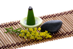 Scent, pebble and flower on mat Royalty Free Stock Images