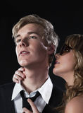 Scent of perfume. Young blond handsome man and pretty blond woman in sunglasses Royalty Free Stock Photo