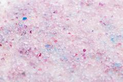 Scented bath salt closeup background in pink and purple colors, top view. Scented bath salt closeup background in pink and purple colors stock photography