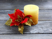 Scented candle with Christmas flower Royalty Free Stock Photos
