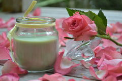 Scented candle and rose. Scented candle and pink rose pictured on the deck Stock Photography
