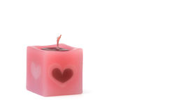 Scented candle. Square pink scented candle on white background Royalty Free Stock Photo