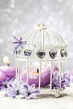 Scented candle in vintage birdcage Stock Image