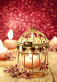 Scented candle in vintage birdcage. Party decoration Stock Photos