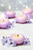 Scented Candles And Violet Hyacinth Flowers Royalty Free Stock Photo