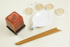 Scented candles and incense sticks Stock Image