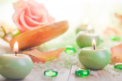 Scented candles salt bath attributes relaxation. Scented candles with salt bath as attributes of relaxation Stock Image