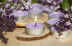 Scented candles on a wooden stand Royalty Free Stock Photos