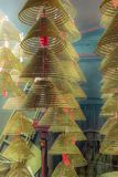 Scented incense coils in a small roadside Buddhist temple in Hon royalty free stock image
