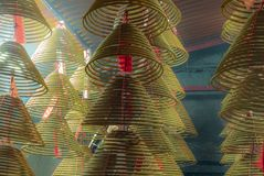 Scented incense coils in a small roadside Buddhist temple in Hon royalty free stock photography