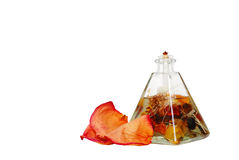 Scented oil lamp with rose petals Stock Images