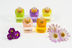 Scented oils and purple flowers Stock Photo