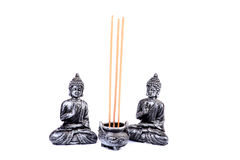 Scented sticks and buddha Stock Images